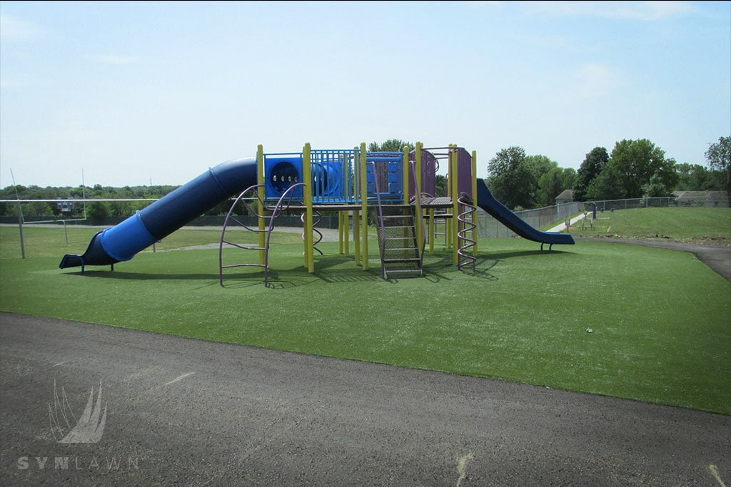 image of john nowlin elementary playground with a blue slide
