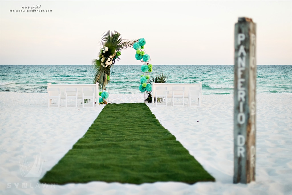 image of beach ceremony photo shoot with artificial grass aisle runner