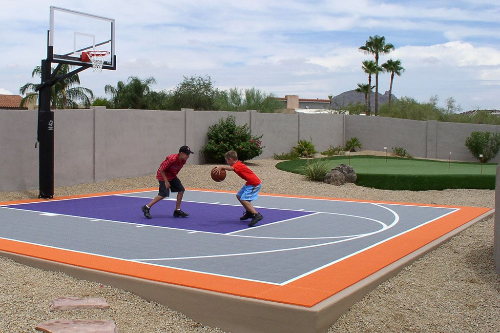 6 reasons to install a backyard basketball court synlawn Backyard basketball courts